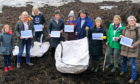 Plastic Free Anstruther members during a beach clean.