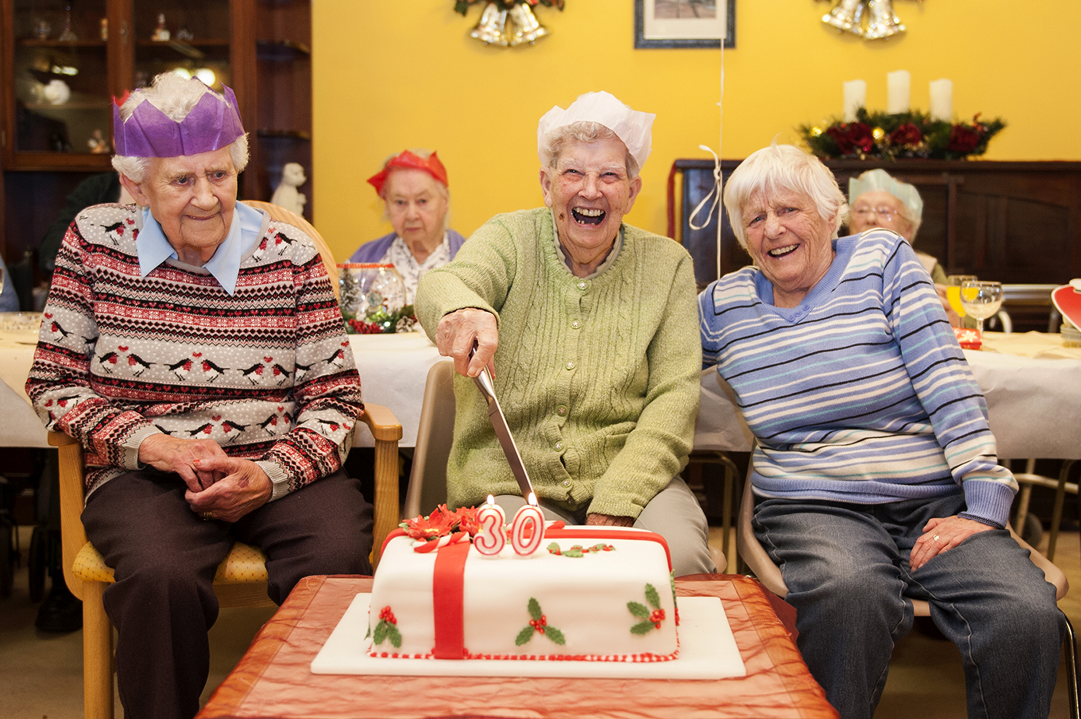 Picture shows, l to r, Ida Anderson, Jean Hardie and Meg Reid cutting the 30th Birthday cake to mark the 30th year of Seaton Grove care home.