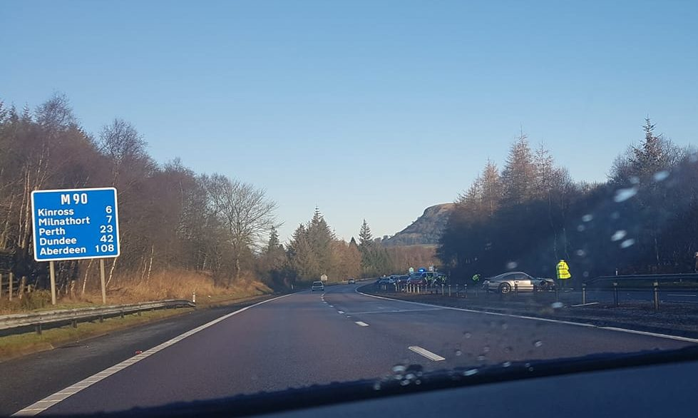 The Porsche hit the central reservation on the M90 near Kelty.