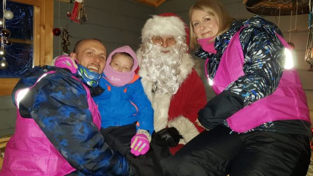 Ruby Stewart with her mum Claire and dad Andy in Lapland