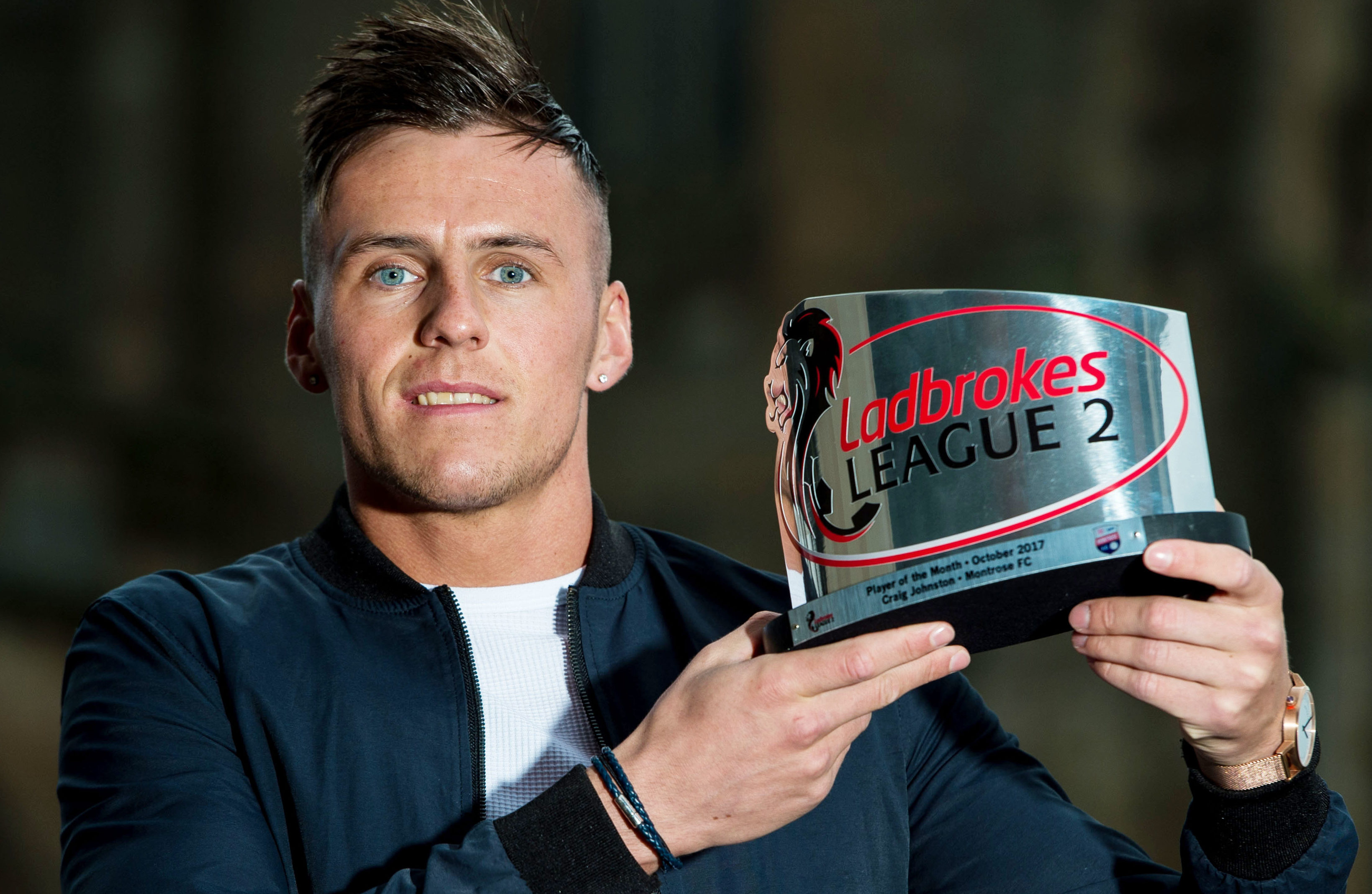 Craig Johnston collecting the Ladbrokes Division 2 player of the month award for October 2017.
