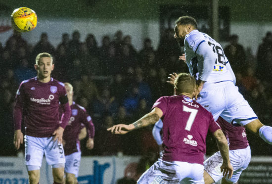Kane Hemmings scores for Dundee at Gayfield.