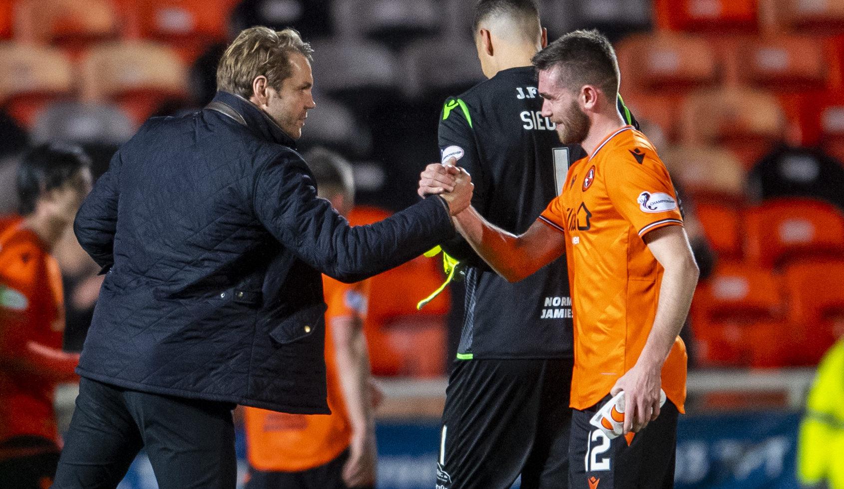 United boss Robbie Neilson and Sam Stanton.