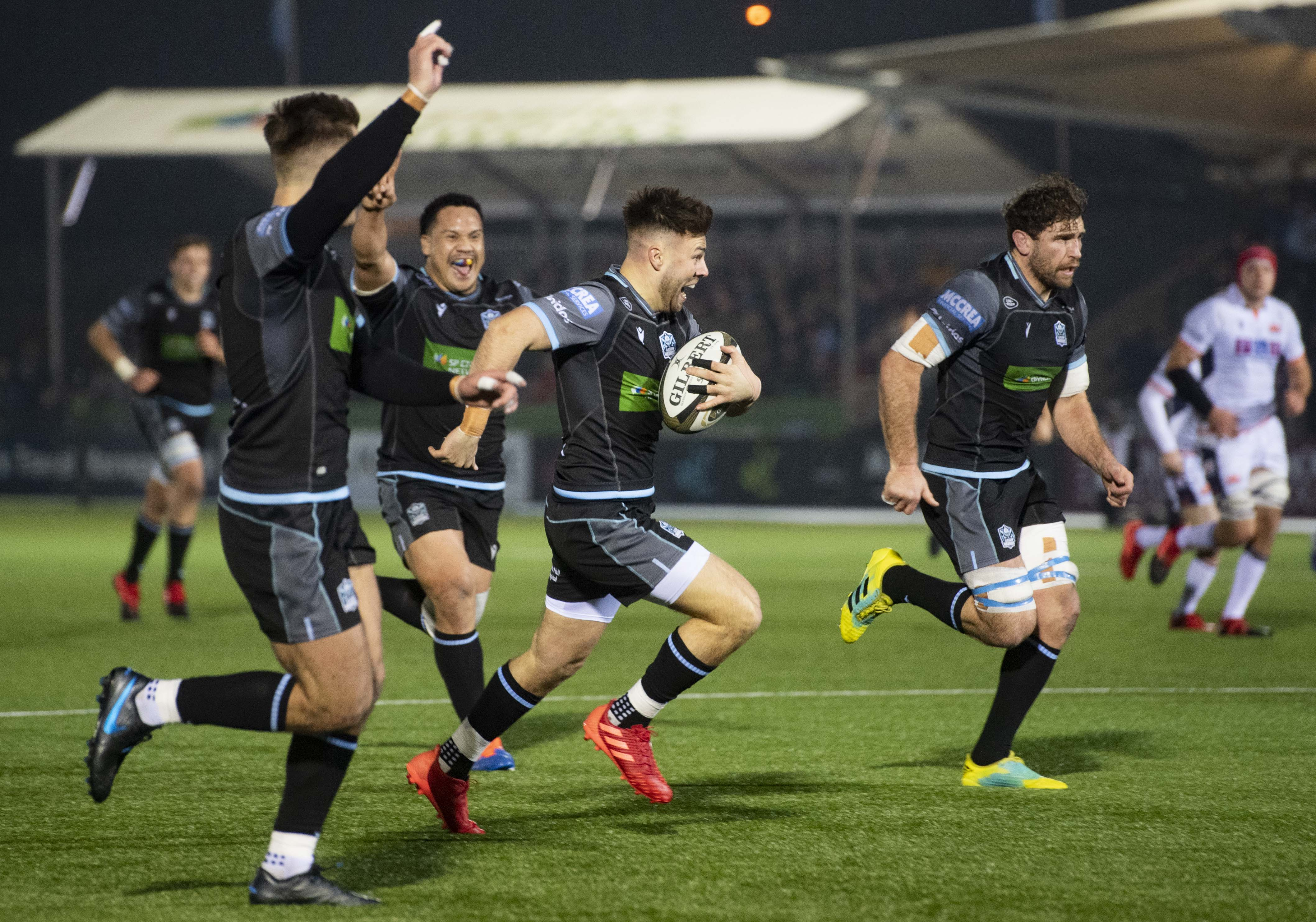 Ali Price runs through to score the opening try during the 1872 Cup mathc at Scotstoun.