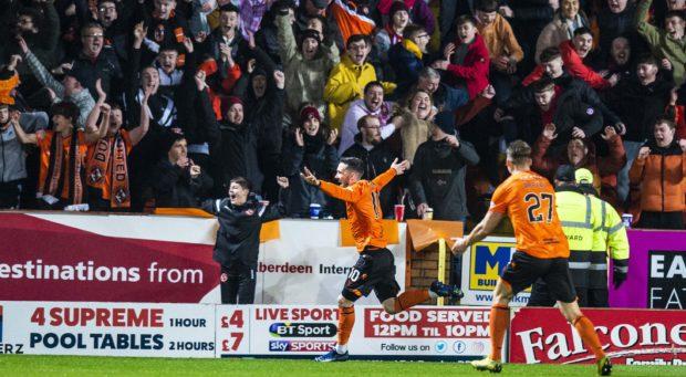 Nicky Clark celebrates making it 1-0 to United.