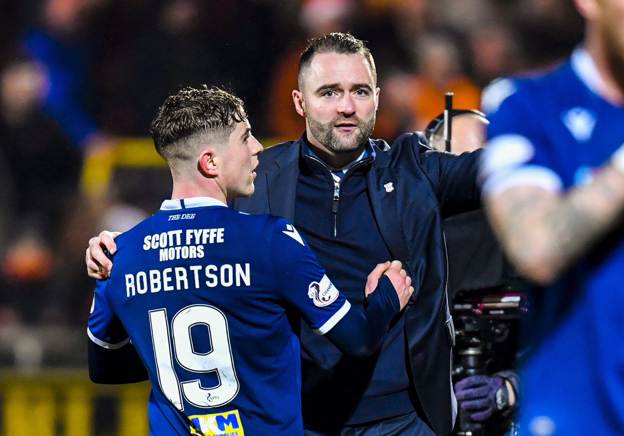 Fin Robertson is congratulated on his display by boss James McPake at full-time in the derby.