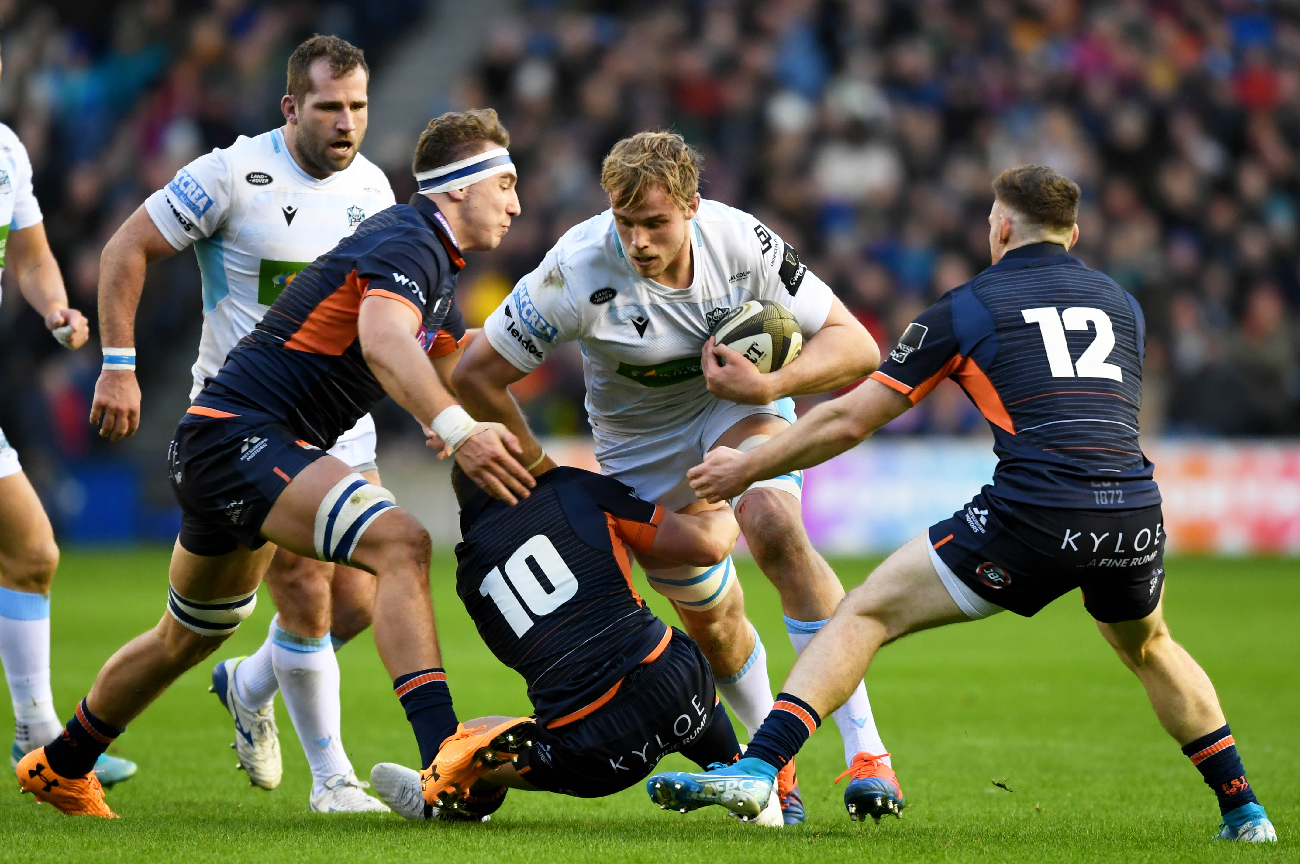 Jonny Gray carries the ball for Glasgow at Murrayfield.