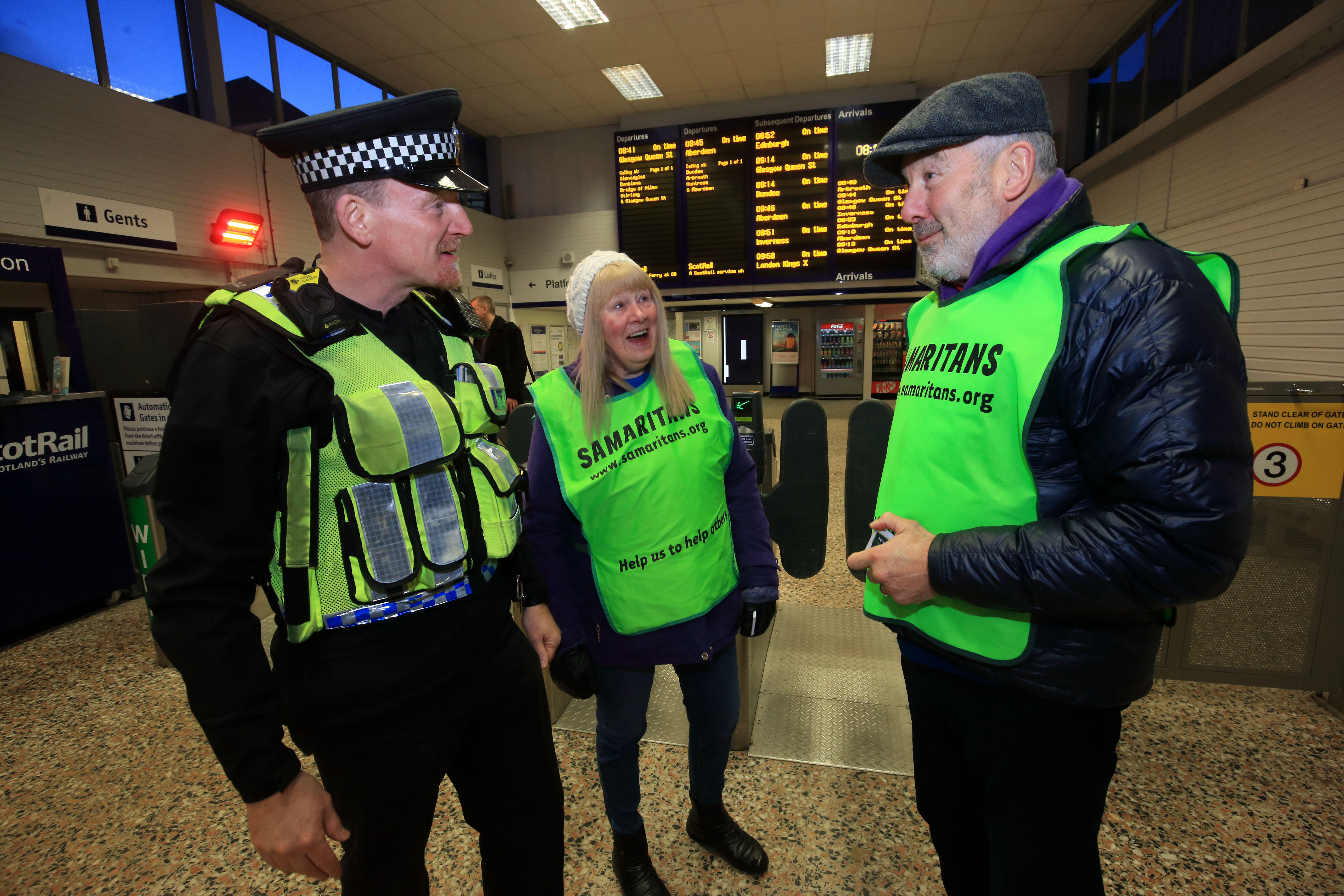 Samaritans Emma and Chris with PC David McDonnagh of the British Transport Police. Picture: Phil Hannah.
