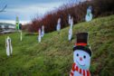 Thieves have stolen snowmen decorations and signage from the display.