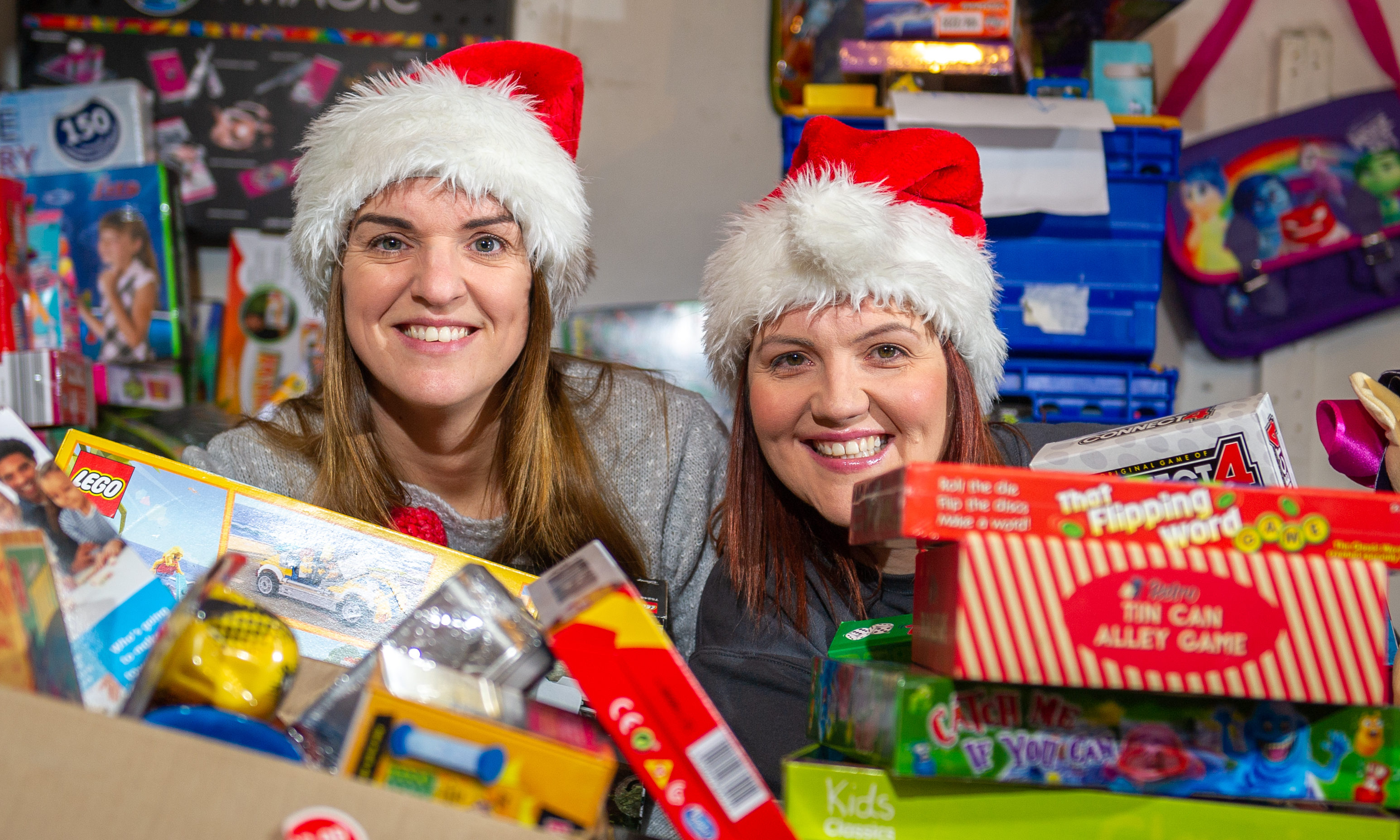 Cupar-based social workers Laura Lumsden and Victoria Leonard with some of the donations to Toy Drive