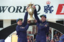 Colin McRae and co-driver Derek Ringer celebrate their world title in 1995.