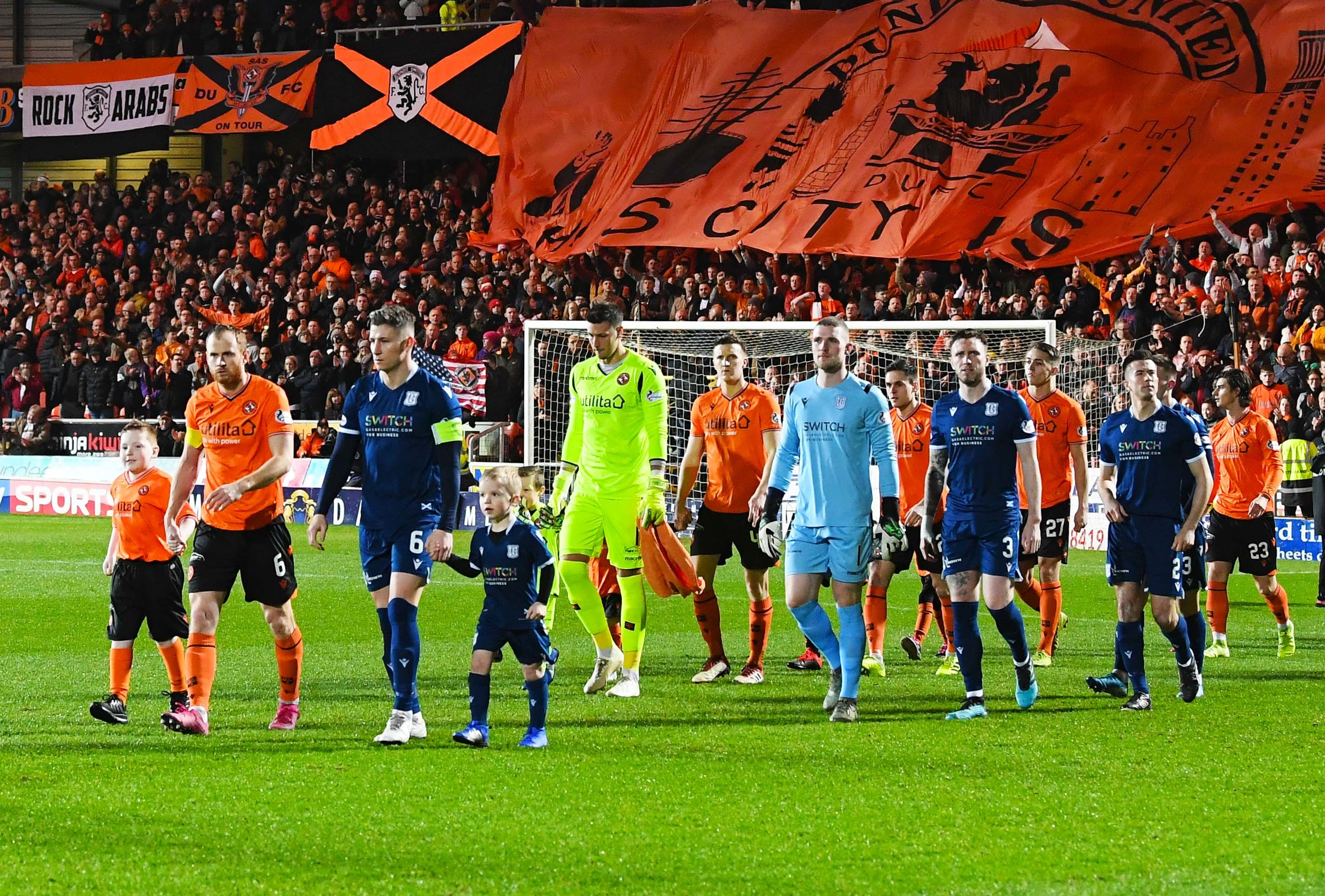 The teams walk out for kick-off.
