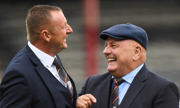 Rab Douglas and Dick Campbell at Dens Park earlier in the season.