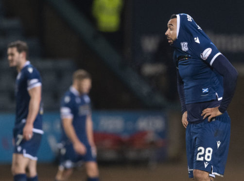 Dundee's Kane Hemmings looks dejected at full-time.