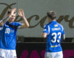 Callum Hendry celebrates his goal with Matty Kennedy