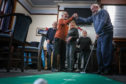 Members on the 'putting green' at the latest meeting of the new group.