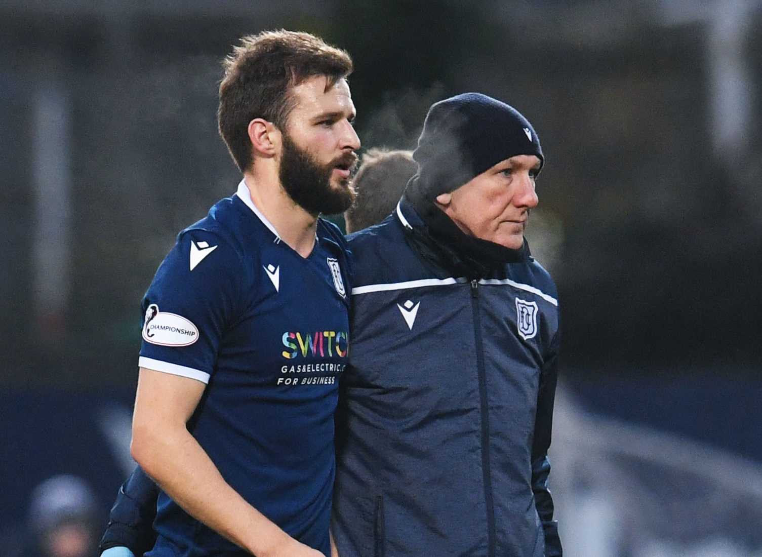 Dundee's Jamie Ness goes off injured on Saturday.
