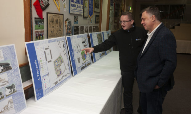 Kevin Spence, architectural manager at GS Brown and Cllr John Rebbeck inspect the plans.
