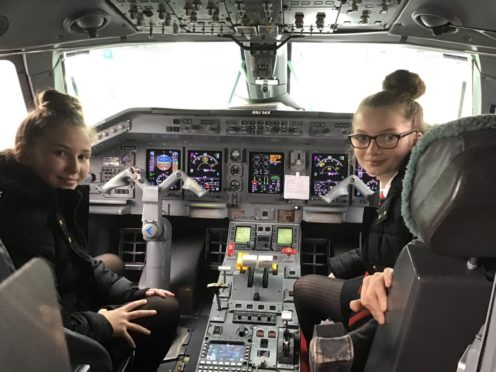 Georgia and Melissa onboard their Loganair flight to East Midlands.