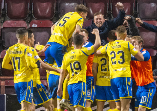 The St Johnstone players celebrate the winning goal against Hearts.