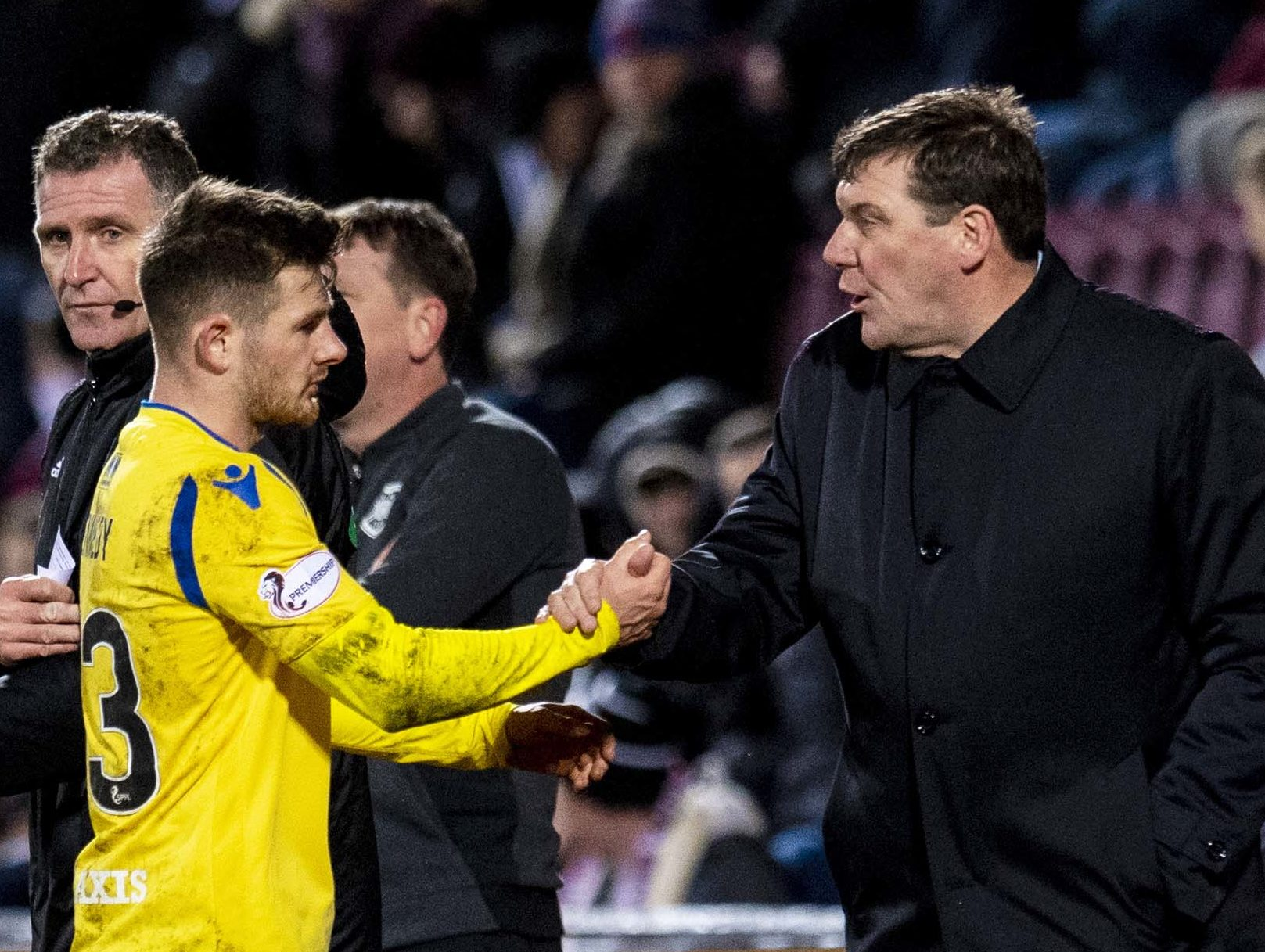 Tommy Wright shakes hands with Matty Kennedy on Saturday.