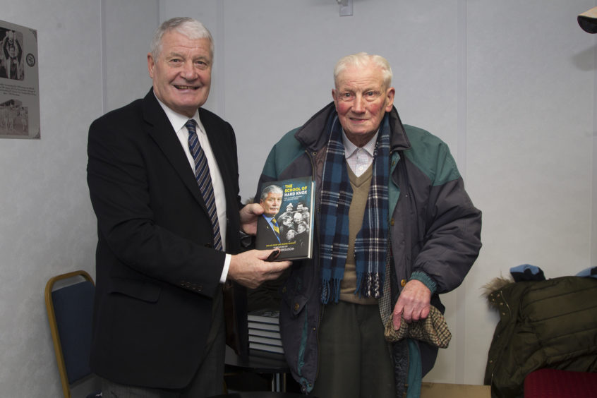 Archie Knox signing his book for Mr Smart when he was 95.