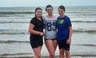 Amelia Peffers, Lois Young and Ellie Peffers spent 26 minutes in the waves at Carnoustie to take the dook prize.