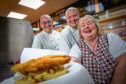 Left: Bert Roncone, Callan Bruce and Margaret Short, who has worked at the chip shop for 35 years.