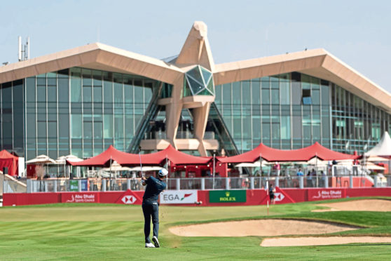 Mandatory Credit: Photo by NEVILLE HOPWOOD/EPA-EFE/Shutterstock (10063811o) Alexander Bjork from Sweden chips onto the green on the 18th hole,  during the first round of the Abu Dhabi HSBC Golf Championship in Abu Dhabi, United Arab Emirates, 16 January 2019. Abu Dhabi HSBC Golf Championship, United Arab Emirates - 16 Jan 2019