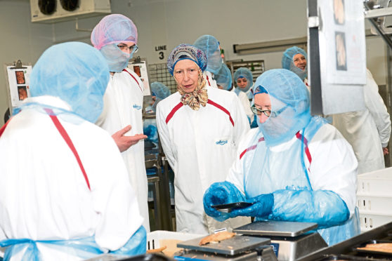 The Princess Royal meets with Konrad Lysowski and Rudita Vitole at RR. Spink in Arbroath