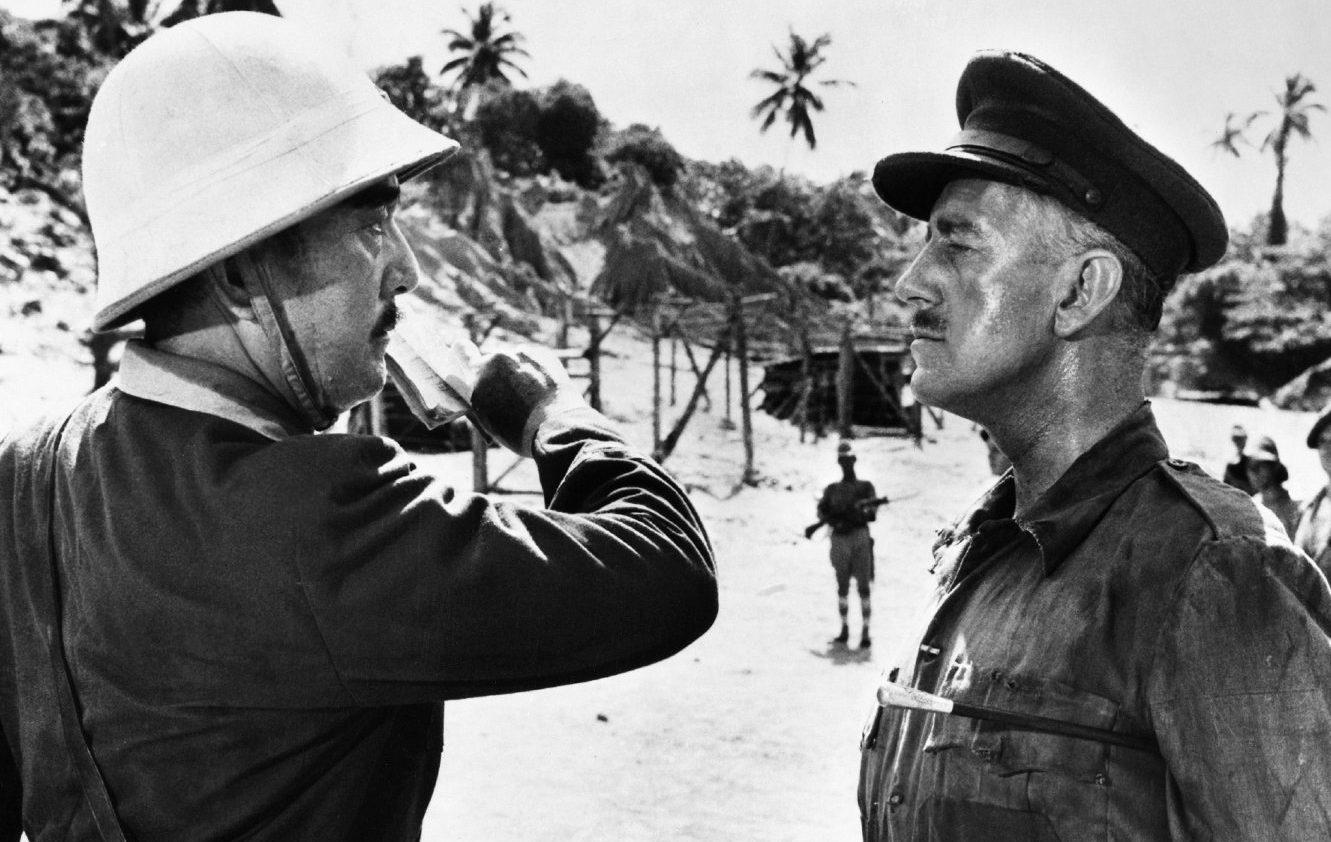 Colonel Saito (Sessue Hayakawa) faces off with Lieutenant Colonel Nicholson (Alec Guinness), the embodiment of the stiff upper lip, in the 1957 film The Bridge Over The River Kwai.