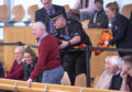 A climate change protester is removed by police from the public gallery during First Minister's Questions at the Scottish Parliament in Edinburgh