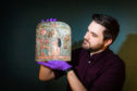 Dr Dan Potter (assistant curator National Museum of Scotland) with a piece from the displays.