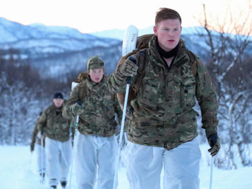 X-Ray and Command Coy begin the movement phase of winter warfare training.