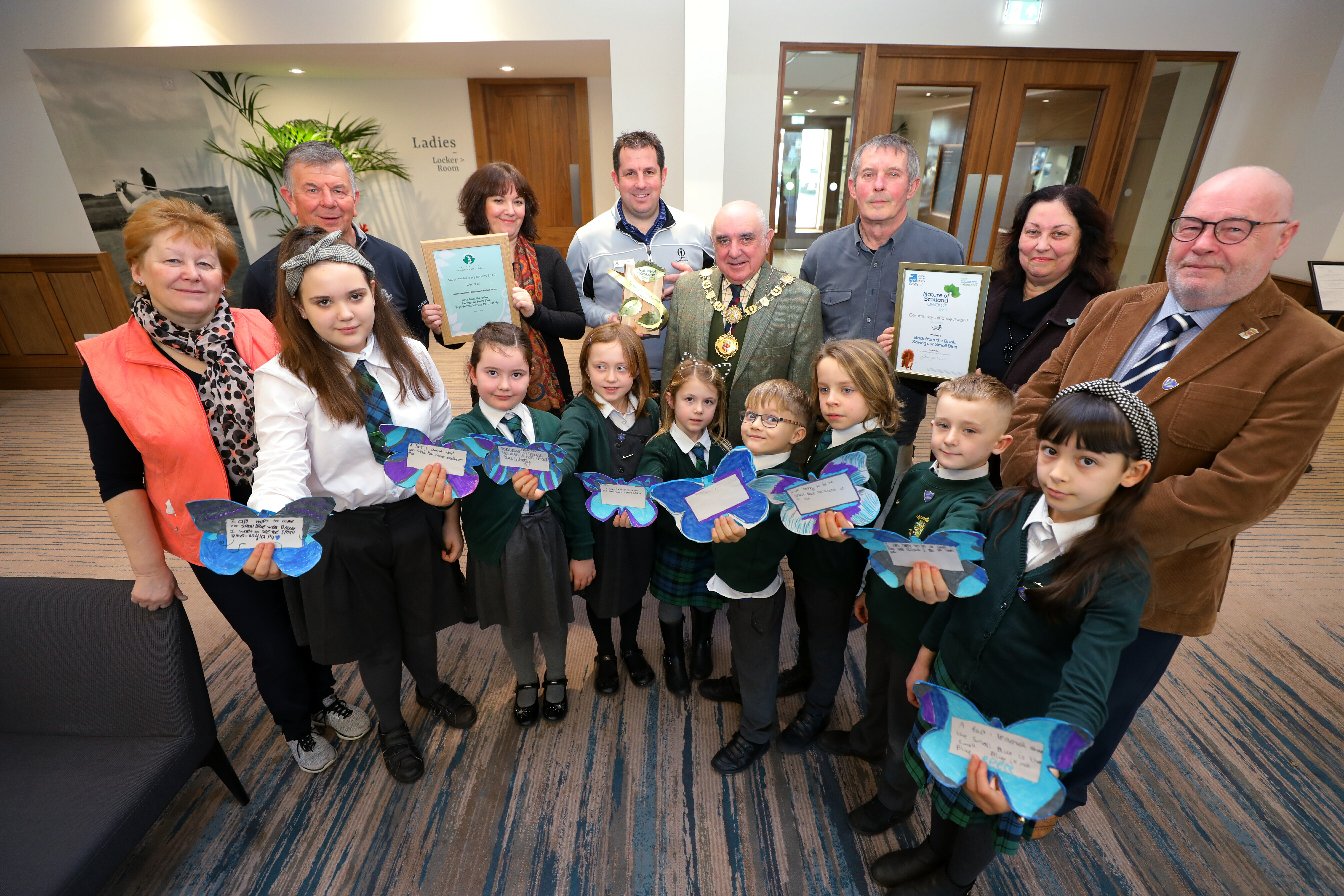 Figures involved in a Tayside Biodiversity Partnership and Angus Council-led project to protect the Small Blue butterfly gathered to celebrate an awards success last week.