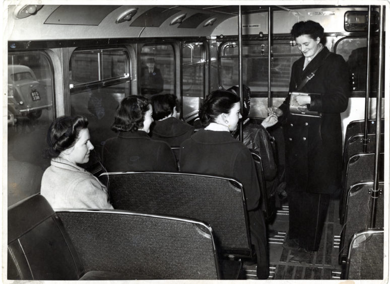 A clippie on a Dundee bus in 1955.