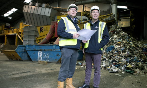 Pictured looking at plans for the new Energy from Waste development are Stuart Fraser (left) Project Manager and Brian Harkins Managing Director.