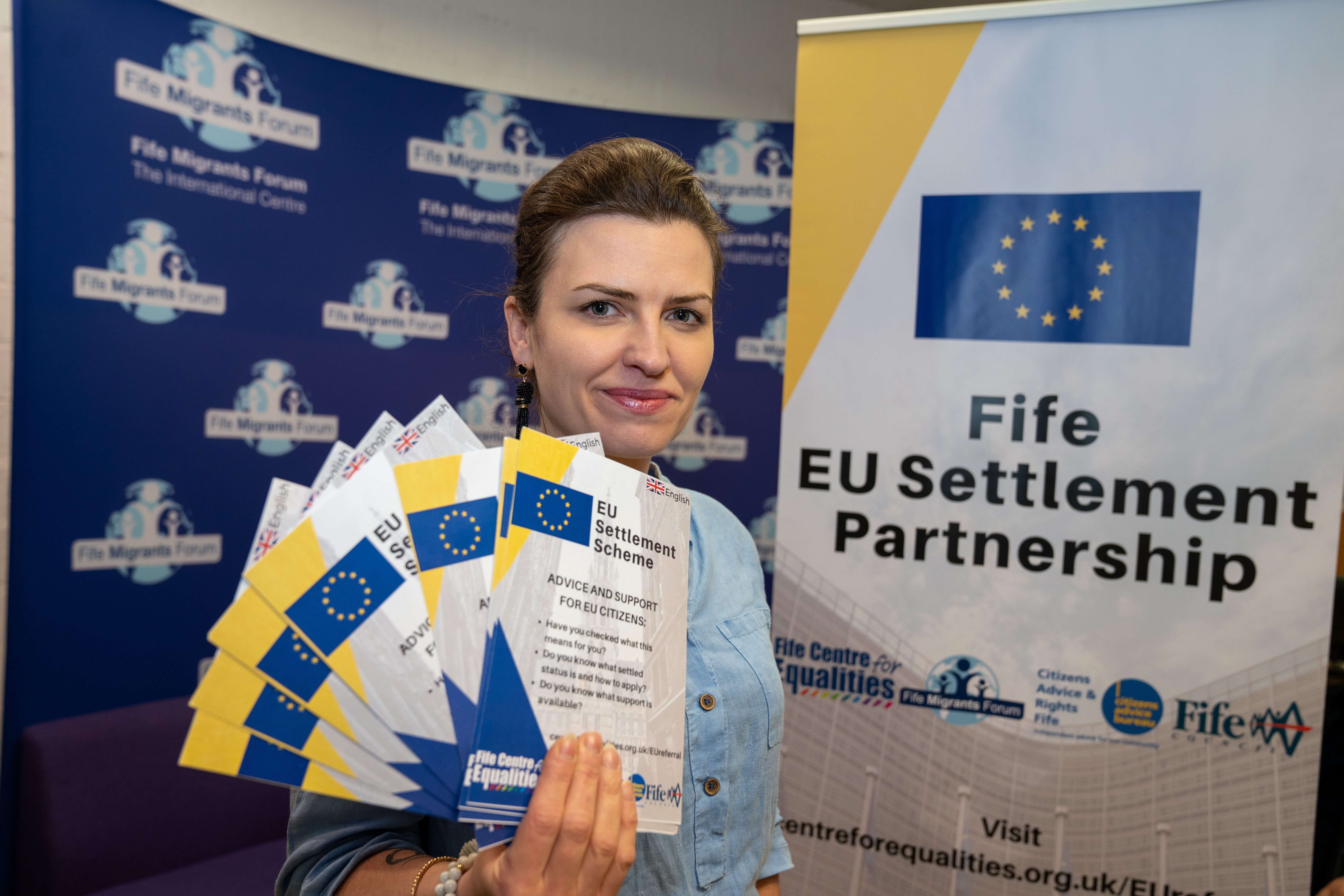 Manager Justyna Majewska with some of the literature on offer from the service outlining the advice and help currently available