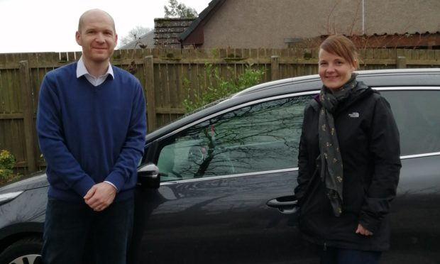 Nikki Murray collects the repaired vehicle from Perth College lecturer Duncan Reid.