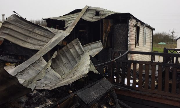 An 86-year-old man was pulled from his caravan near Windygates as it was destroyed by fire.