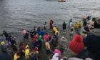 People brave the sea at the Broughty Ferry dook.