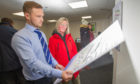 L to r - Ryan Brown (Land Manager GS Brown) and visitor to the event outling the proposals, Lorna Pattison, Mackie Motors, Clerk Street, Brechin, 15th January 2020, Kim Cessford / DCT Media.