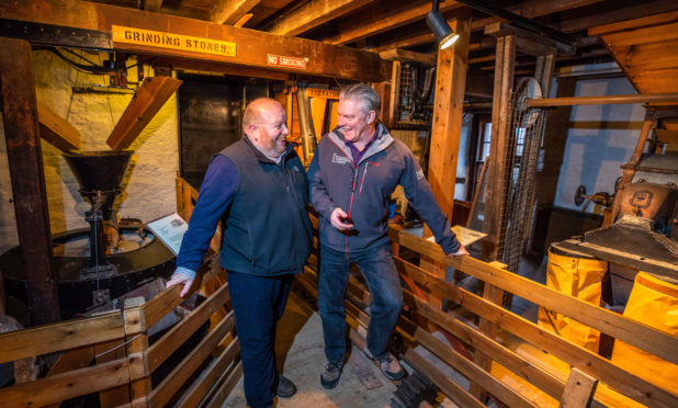 Colin Tennant (Historic Environment Scotland) and right is David Strachan (Director Perth & Kinross Heritage Trust) discuss plans for Lower Mills