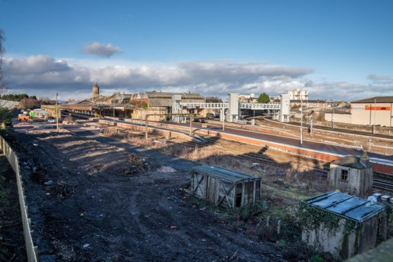 Railway tracks at Perth railway station of where trees have been felled.