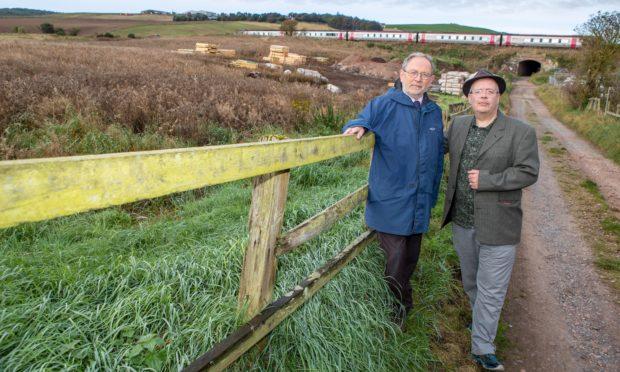 Councillors Tim Brett, left, and Jonny Tepp at the site of the development.