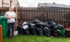Evelyn Grieve, who has not had her bins emptied for a whole year due to a dispute with a neighbour.