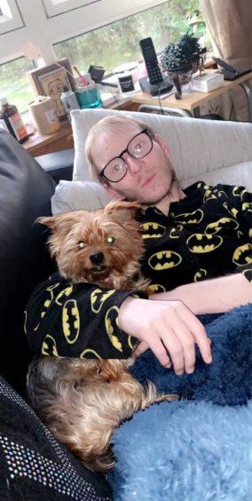 Ross Scott with his mum's dog, Koko.