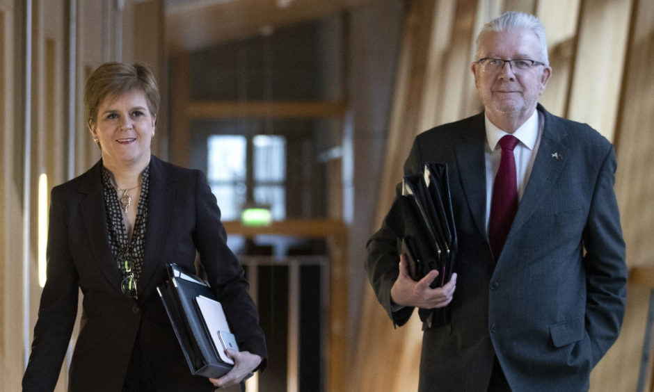 First Minister Nicola Sturgeon and Cabinet Secretary for Government Business and Constitutional Relations Mike Russell arrive ahead of the Holyrood debate on 'Scotland's Future'.