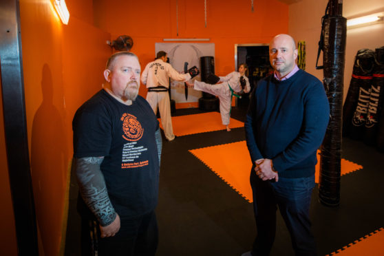 Angus school Education Convener Derek Wann meeting anti-bullying champion and martial arts expert Mark Davies who includes anti-bullying in his school's children's curriculum.