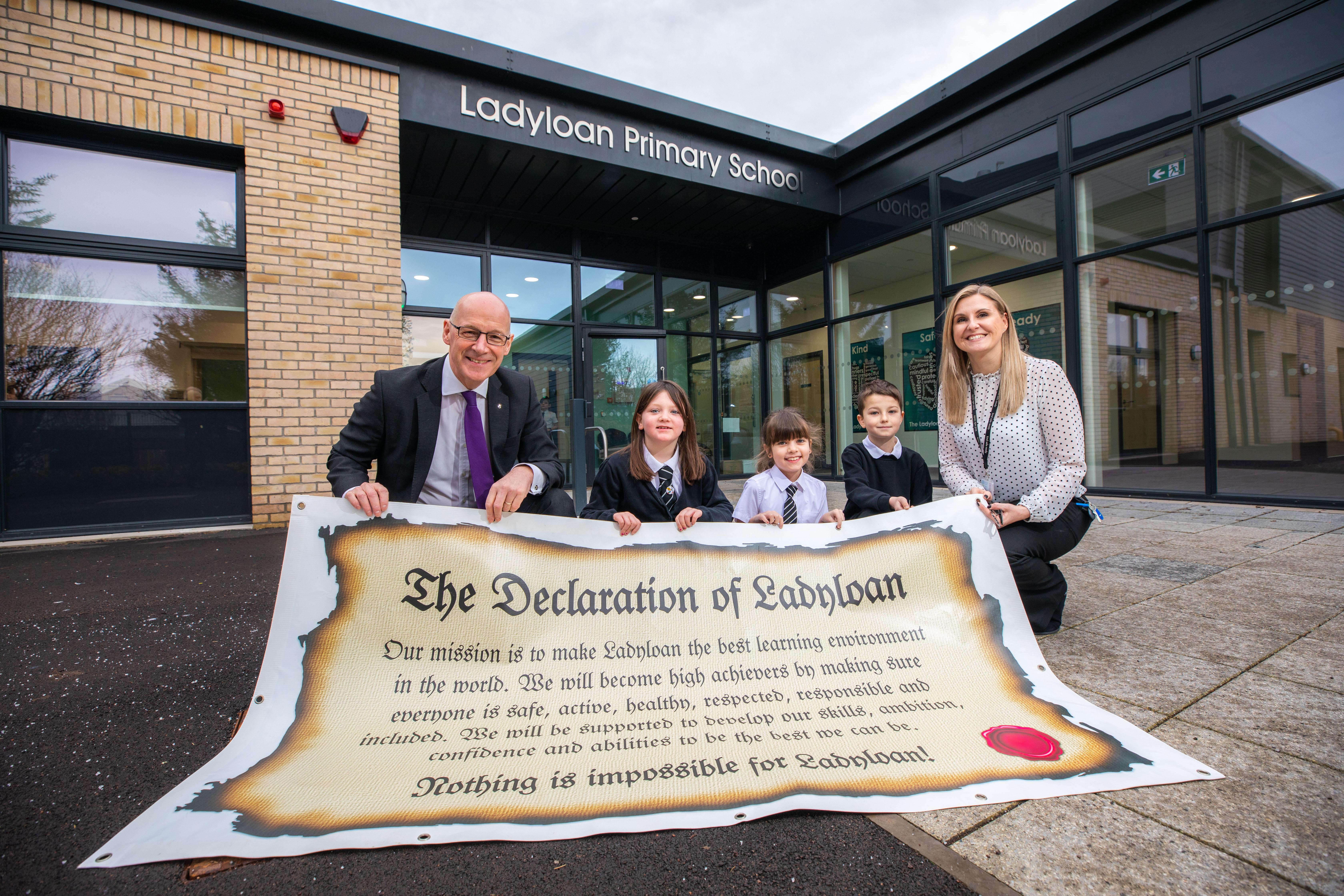 John Swinney MSP, Eva Dissel (Primary 4), Imogen Hawkins (Primary 4), Ollie Franks (Primary 5) and Jill Davie (Head Teacher Ladyloan Primary School).